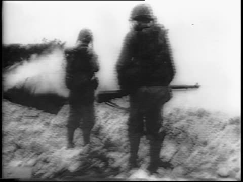 troops finish up the philippine invasion / a soldier sprays fire into a large hole / a japanese soldier tries to run but is shot down / grenade... - japanese surrender stock videos and b-roll footage