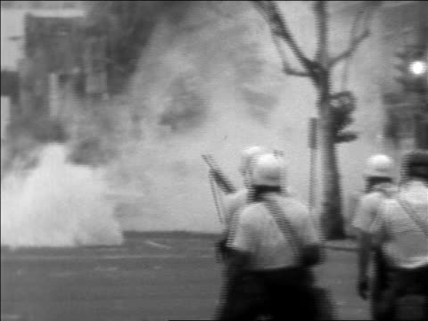 b/w 1968 troops fire tear gas on street after assassination of martin luther king / washington dc - 1968年点の映像素材/bロール