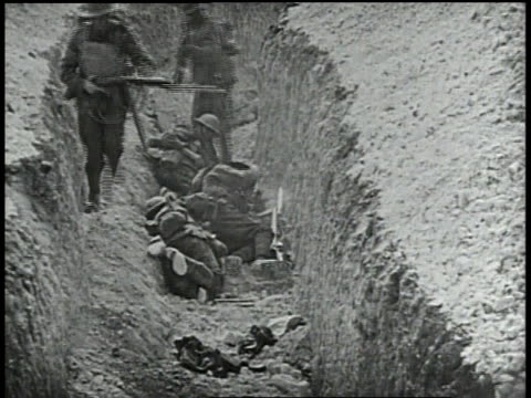 troops firing at downed soldiers / troops running through a trench - trench stock videos & royalty-free footage