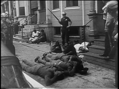 troops forcing black men onto ground after newark race riots, nj / newsreel - 1967 bildbanksvideor och videomaterial från bakom kulisserna