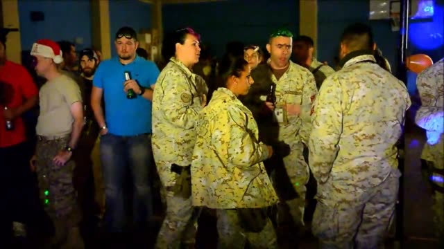 troops from the international security assistance force take part in celebrations on new year eve right before the start of the year 2013 in kabul.... - international security assistance force stock videos & royalty-free footage