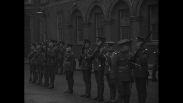 ms troops line up outside dublin castle as officer inspects them / ms troops march on castle grounds - sinn fein stock videos & royalty-free footage