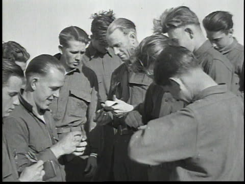troops lining up in front of table officer handing out envelopes / workers opening mail / sergeant counting money smiling - civilian conservation corps stock-videos und b-roll-filmmaterial