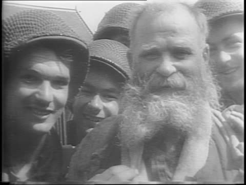 troops march in formation into the city square of cherbourg / citizens of cherbourg come out of hiding / liberated russians pose for the camera / us... - fascism stock videos & royalty-free footage