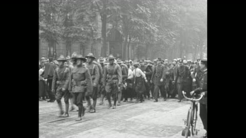 troops march in paris street as they join parisians' celebration of us independence day / women join the procession and french soldiers and civilians... - world war one stock videos & royalty-free footage