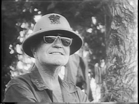 vídeos de stock e filmes b-roll de troops marching along shoreline / close-up of admiral william halsey, then climbing into and riding in jeep / halsey looking over maps / troops march... - veículo de construção