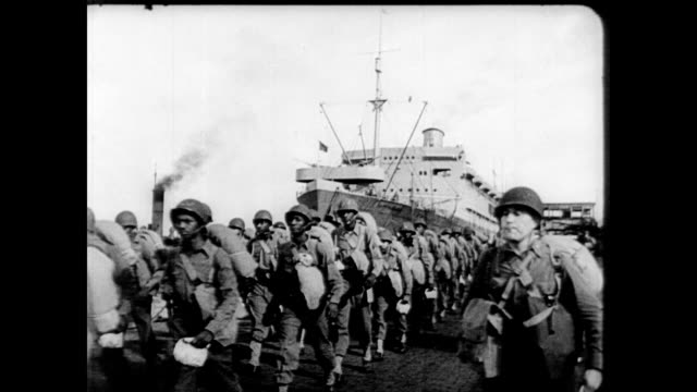 / troops marching along the harbor / tanks artillery and planes on the ground in rows / cu supreme commander dwight eisenhower conferring with... - fallschirmjäger stock-videos und b-roll-filmmaterial