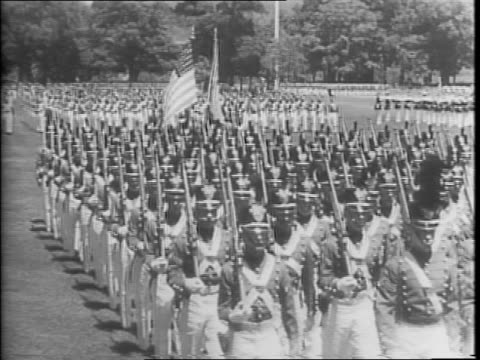 troops marching in a field during a graduation ceremony at west point military academy / closer view of troops parading, line of soldiers and... - ウェストポイント点の映像素材/bロール
