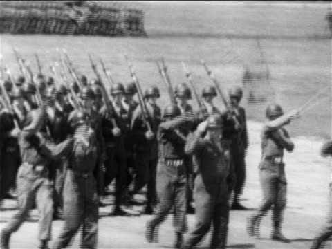 us troops marching in parade / end of korean war / newsreel - armistizio video stock e b–roll