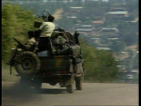 troops move into safe areas itn lib rpf troops along on military vehicles ms troops at roadblock - blocco stradale video stock e b–roll