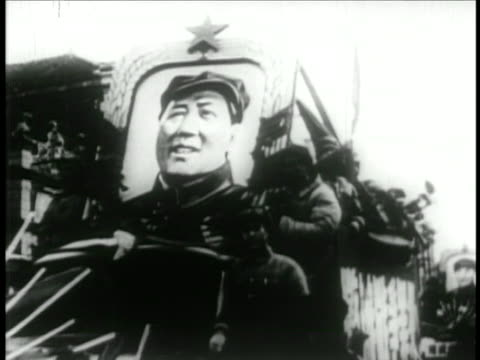 troops moving thru streets with large portrait of chairman mao / educational - mao tse tung video stock e b–roll