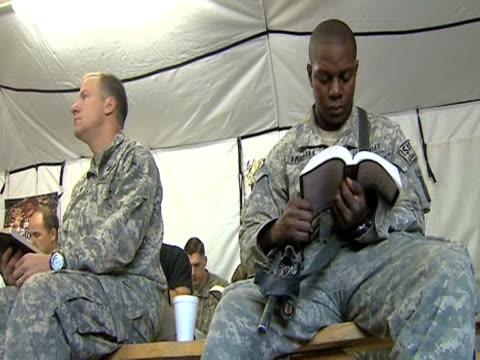 us troops on foot patrol in afghanistan 28 january 2010 - 2001年~ アフガニスタン紛争点の映像素材/bロール