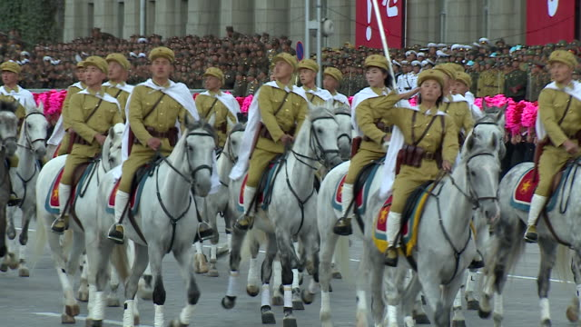 troops on horseback take part in a military parade at kim ilsung square pyongyang - pyongyang stock videos and b-roll footage