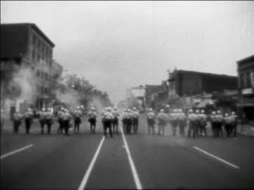 vidéos et rushes de troops on street after assassination of martin luther king / washington dc - 1968