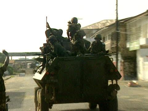 ECOMOG troops ride on tank Monrovia 1997