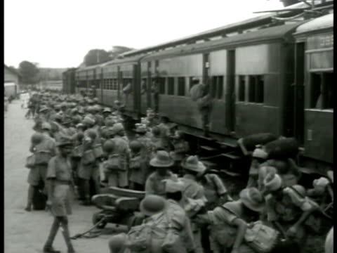 stockvideo's en b-roll-footage met troops soldiers getting out of train boarding ship walking up gang plank ramp soldier standing guard on transport dock w/ transport ship bg colonial... - 1942