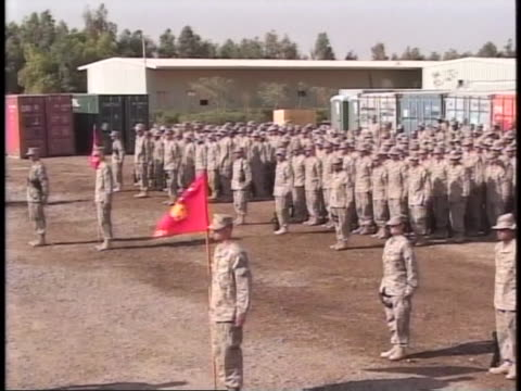 troops stand at attention at a purple heart ceremony. - al fallujah stock videos & royalty-free footage