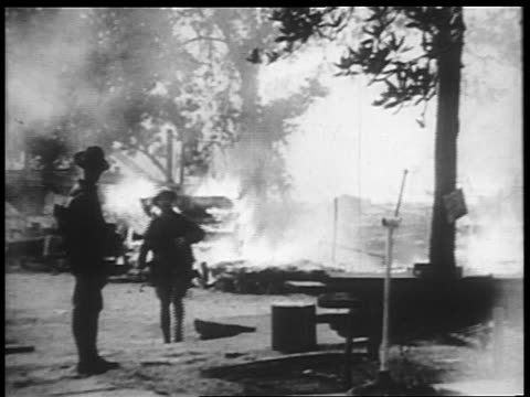 s troops standing near burning camp of veterans / bonus march / washington dc - 1932 stock videos and b-roll footage