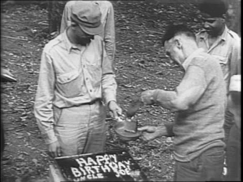 vídeos de stock, filmes e b-roll de us troops taking a break from battle to celebrate general joseph stilwell's birthday with a cake / closeup of birthday cake 'happy birthday uncle... - guerra do pacífico
