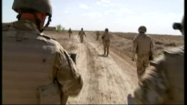 troops to take over from british soldiers in sangin; afghanistan: sangin: british soldiers blowing up improvised explosive devices on road and troops... - herunterlassen stock-videos und b-roll-filmmaterial