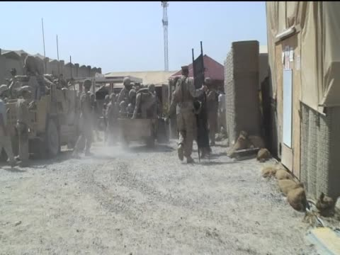 Troops transport injured comrades Sangin