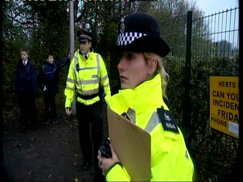 witness appeals england hertfordshire stevenage police officer talking to woman during hunt for witnesses to the latest attack by the trophy rapist... - stevenage stock videos and b-roll footage