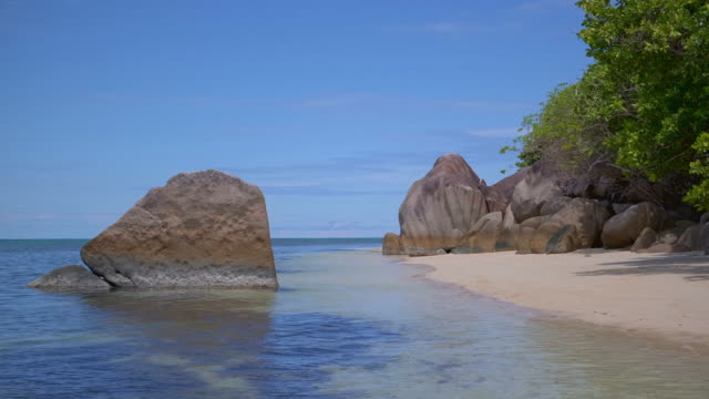tropical beach anse citron with typical granite rock formations on praslin island , granitic seychelles , archipelago country in the indian ocean - granite rock stock videos & royalty-free footage