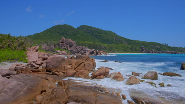 tropical beach anse songe with typical granite rock formations on la digue island , granitic seychelles , archipelago country in the indian ocean - granite rock stock videos & royalty-free footage