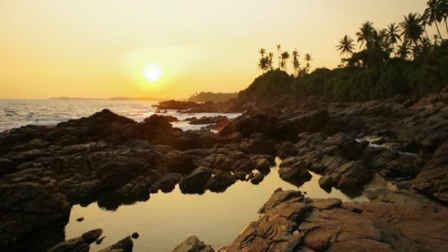 tropical beach at sunset. thailand - tide pool stock videos & royalty-free footage