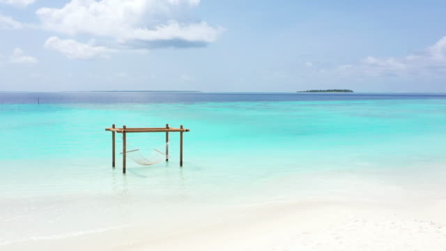 tropical beach in the ocean, maldives - hammock stock videos & royalty-free footage