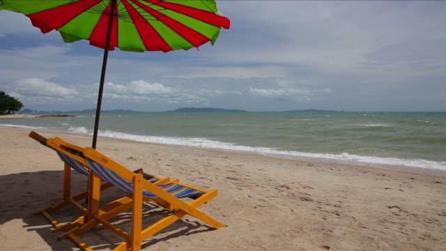 tropical beach - beach umbrella stock videos and b-roll footage