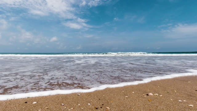 tropical beach with waves crashing on sand vacation scene - low angle view stock videos & royalty-free footage