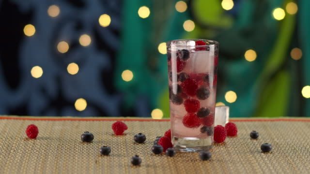 tropical berry drink pouring in ice - tropical drink stock videos & royalty-free footage