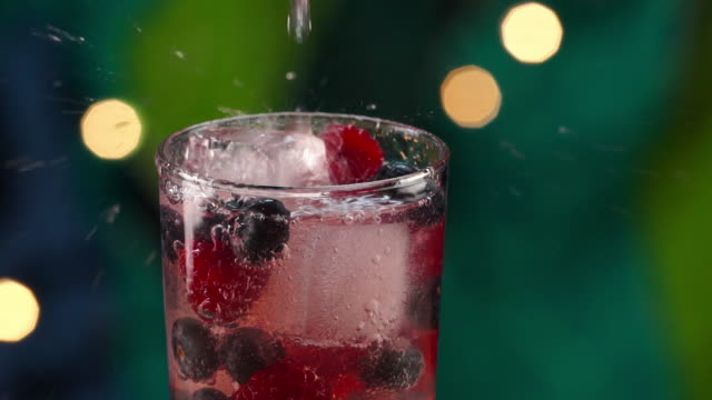 tropical berry drink pouring in slow motion - tropical drink stock videos & royalty-free footage