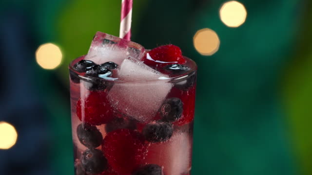 tropical berry drink splashing in ice slow motion - tropical drink stock videos & royalty-free footage