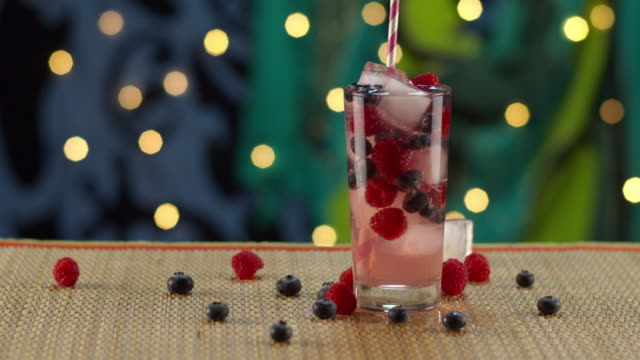tropical berry drink splashing in ice - tropical drink stock videos & royalty-free footage