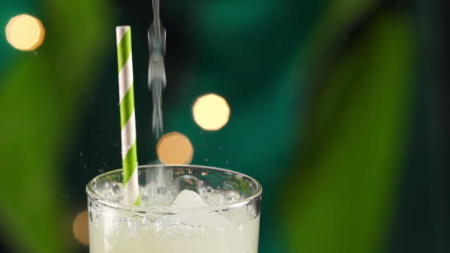 tropical citrus lime drink pouring in slow motion - tropical drink stock videos & royalty-free footage
