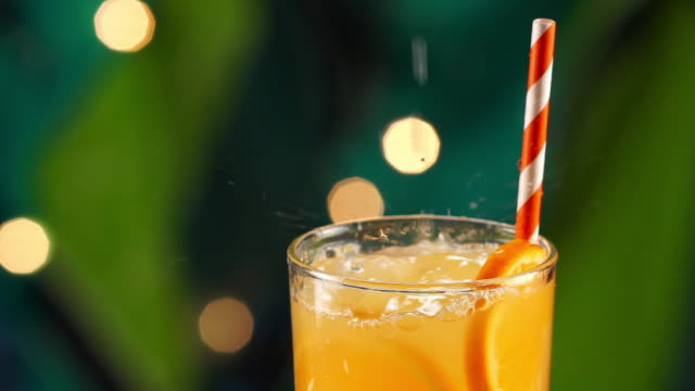 tropical citrus orange drink pouring in slow motion - tropical drink stock videos & royalty-free footage