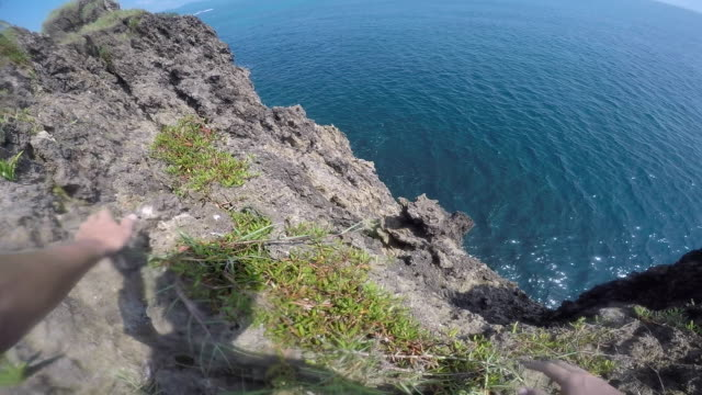 pov tropical cliff jump - cliff stock videos & royalty-free footage