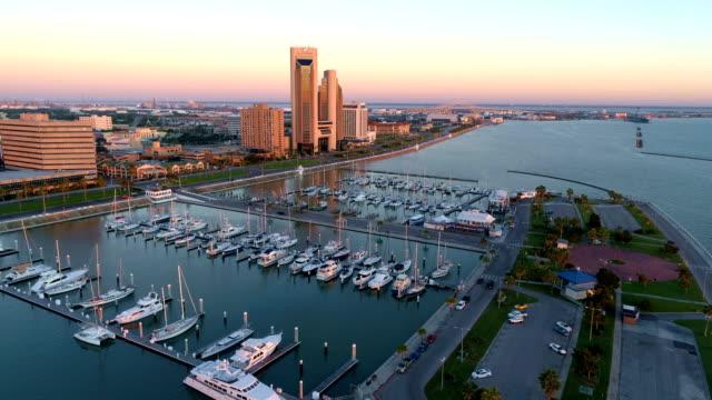 tropical dawn sunrise high above gulf coast city of corpus christi , texas , usa aerial drone view - corpus christi texas stock videos & royalty-free footage