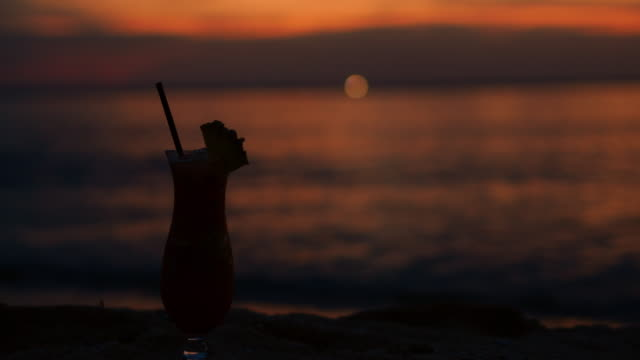 tropical drink on beach at sunset - tropical drink stock videos & royalty-free footage