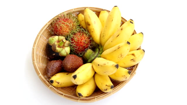stockvideo's en b-roll-footage met tropical fruits. - mand