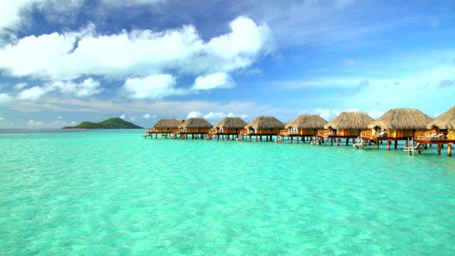 vidéos et rushes de tropical holiday resort with overwater bungalows bora bora - îles du pacifique