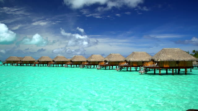 tropical holiday resort with overwater bungalows bora bora - polynesian ethnicity stock videos & royalty-free footage