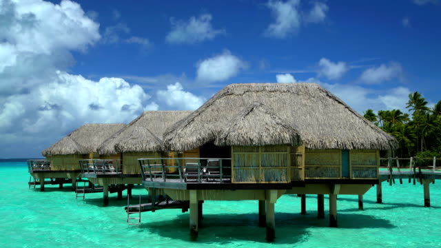 tropical holiday resort with overwater bungalows bora bora - bungalow stock videos and b-roll footage