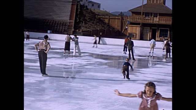tropical ice gardens the world's first yearround outdoor iceskating rink / children and adults skating on the newly built rink in westwood village... - figure skating stock videos & royalty-free footage