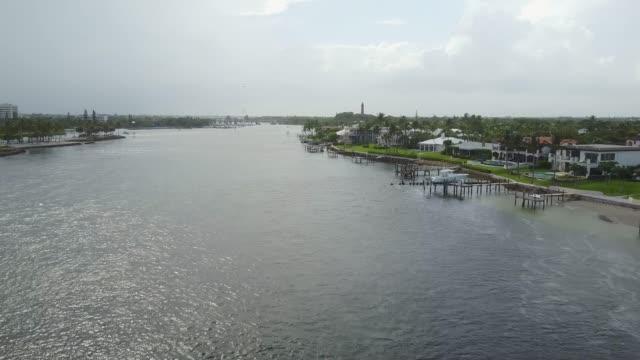 tropical inlet & ocean aerial views in jupiter, florida - inlet stock videos & royalty-free footage