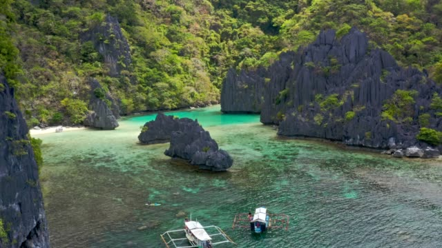tropical island beach lagoon in palawan, philippines - philippines stock videos & royalty-free footage