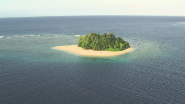 Tropical island, coral reef and ocean beyond, Guadalcanal, Solomon Islands