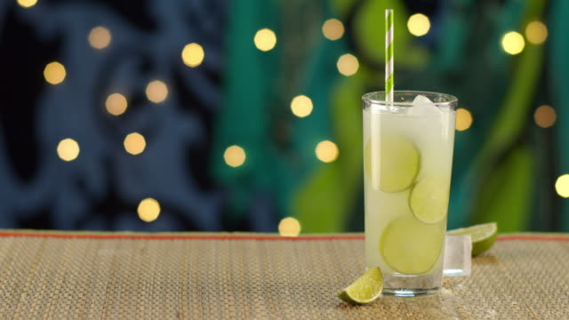 tropical lime drink pouring in ice - tropical drink stock videos & royalty-free footage
